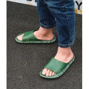 Прикольні зелені тапочки з рядком на підошві